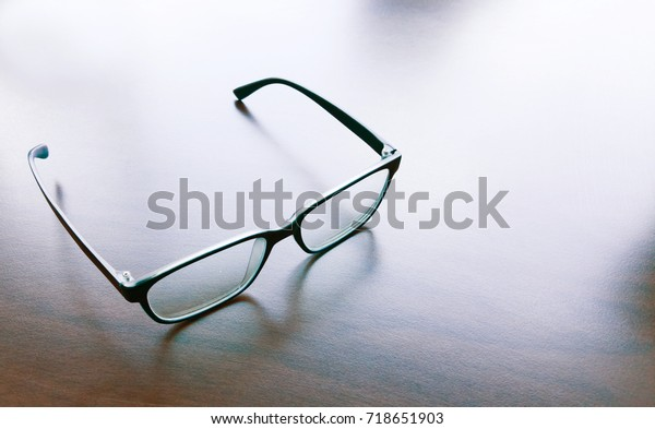 Modern style eyeglasses, spectacles or glasses on solid surface.