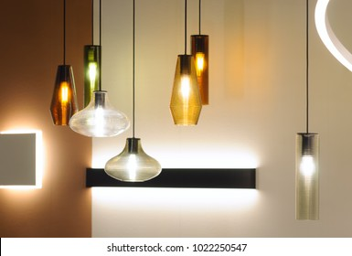 Modern style lamps in interior design. Decoration with different form lampshades combination