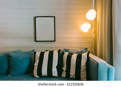 Modern style living room with pillows on sofa and lamp at beside