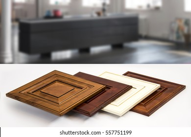 Modern style of wood kitchen cabinet doors, background blurry living room.