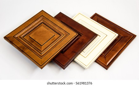 Modern style of wooden kitchen cabinet doors, background blurry living room.