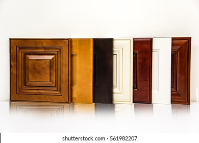 Modern style of wooden kitchen cabinet doors, background white wall