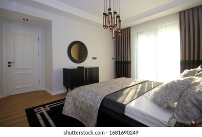 Modern and Stylish Bedroom Design with Furniture and Decorative Accessories at the New Home