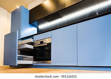 Modern and Stylish Blue Kitchen Cabinets and Open Drawers