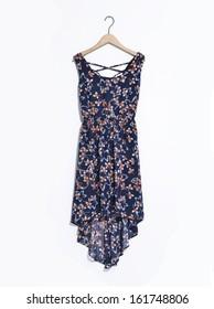 Modern, stylish dress isolated on hangers