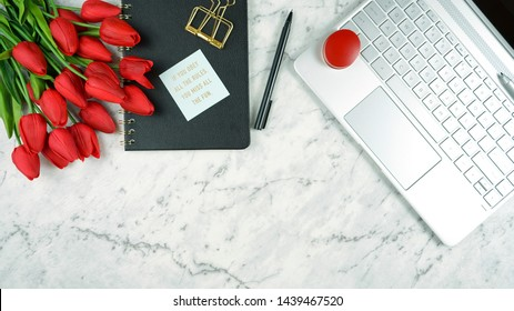 Modern stylish feminine desk or workspace coffee break with high tech touchscreen laptop and red female accessories, with copy space