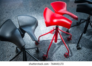 Modern Stylish Red And Black Chair Without Backrest In The House
