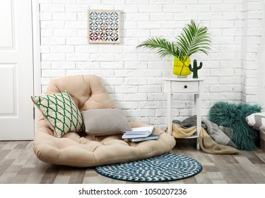 Modern stylish room interior with tropical leaves in glass vase