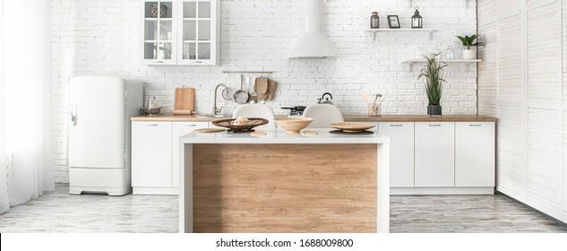 Modern stylish Scandinavian kitchen interior with kitchen accessories. Bright white kitchen with household items .