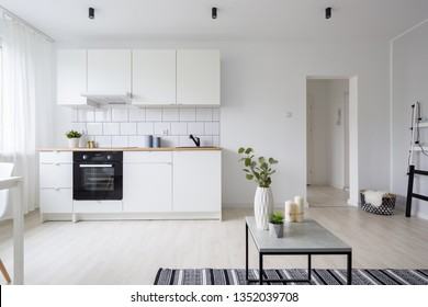 Modern and stylish studio apartment in white with functional kitchenette