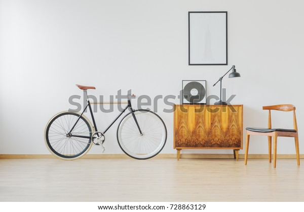 Modern and stylish vintage apartment for hipster student with bike and wooden retro furniture