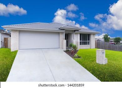 Modern suburban house on sunny day