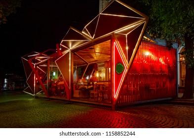 Modern summer terrace of restaraunt, exterior. Futuristic, geometrical form. At night .Background.Creative form