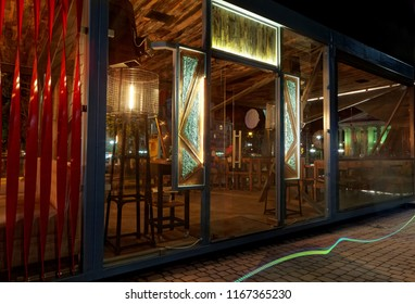 Modern summer terrace of restaraunt, exterior. Futuristic, geometrical form. At night .Background.Creative form
