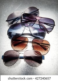 modern sunglasses on a composition with a beautiful light with shadows in pan