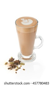 Modern supply masala tea. Masala tea in a glass for latte. Masala tea with latte art. spice cardamom, star anise, cloves and cinnamon.