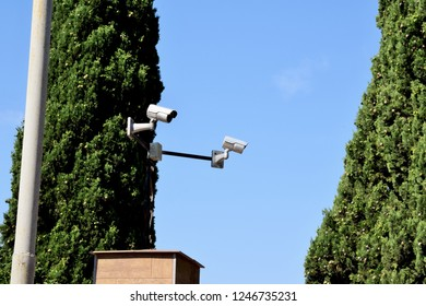 modern surveillance cameras around the perimeter of the house fence