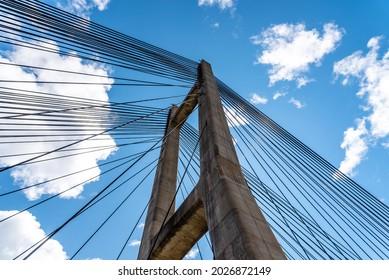 Modern suspension bridge across reservoir Los Barrios de Luna in Castile and Leon, Spain. Carlos Fernandez Casado Bridge. Low angle view against sky