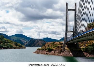 Modern suspension bridge across reservoir Los Barrios de Luna in Castile and Leon, Spain. Carlos Fernandez Casado Bridge