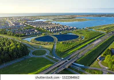 Modern sustainable neighbourhood in Almere, The Netherlands. The city heating (stadswarmte) in the district is partially powered by a solar panel island (Zoneiland). Aerial shot.