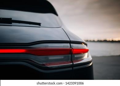 Modern suv car rear taillamp at evening