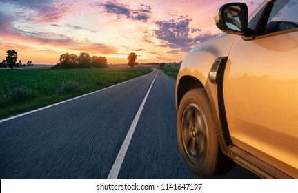 modern SUV on the German road at sunset