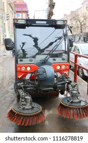 Modern sweeper collector cleans pavement in the spring city