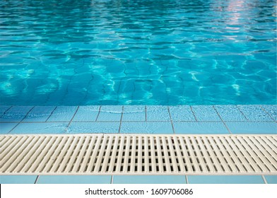 Modern Swimming Pool Overflow Grating Closeup. Pool Technologies.