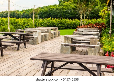 Modern table and chair in park, Thailand.
