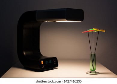 modern table lamp with digital clock vintage  black silver midcentury design spaceage front top side view green dial loft warm light metal orange switch arc lamp isolated on white HIGH RESOLUTION