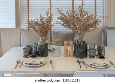 modern table set on white wooden dining table in modern dining room, interior design concept