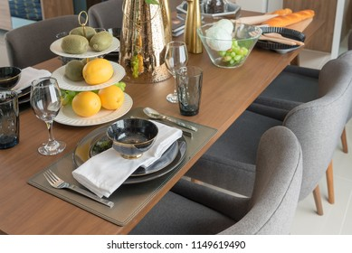 modern table set on wooden dining table in modern dining room, interior design concept
