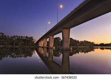Modern tall bridge over Murray river near Mildura as a boundary between NSW and VIC in Australia at sunrise