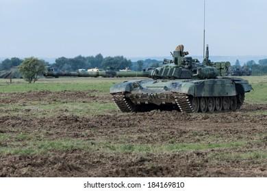 Modern tank on battle field aiming