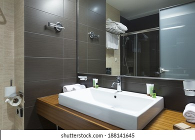 Modern tap and water basin in hotel bathroom