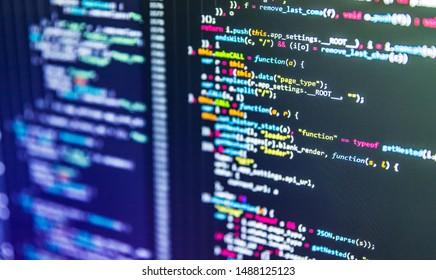 Modern tech. Program development concept. Developer working on program codes in office. Vignette light and dark shadow dramatic effect. Shallow depth of field, selective focus effect