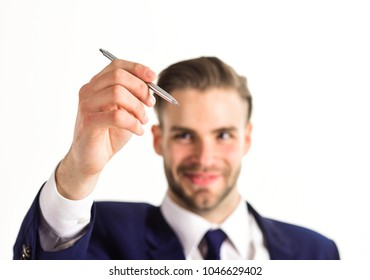 Modern technologies and business concept. Man with smiling face writes defocused, close up Businessman holds pen or stylus and work with modern technology or touch screen isolated on white background.