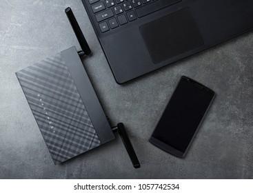 Modern technology-wireless LAN-Wi-Fi, computer and phone on gray