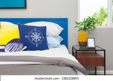 Modern teen bedroom with blue navy decoration style.