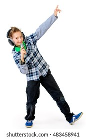 Modern teen boy sings emotionally with a microphone on stage. Isolated over white.