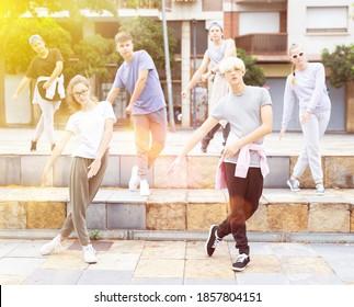 Modern teenage street dancers performing outside in summer. Urban lifestyle .
