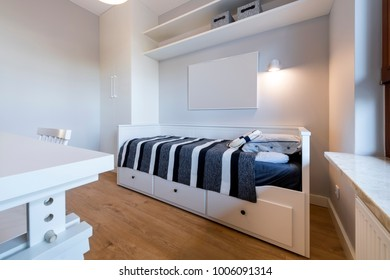 Modern teenager room in maritime style in white finishing