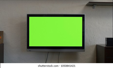 Modern television with chroma key green screen. A modern LCD TV with a green screen