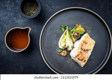 Modern Thai fried cod fish filet with bok choi and mushroom as top view on a plate