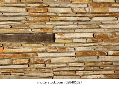 Modern Tiled Stonewall From Flagstone And Limestone Slabs, Background Texture Close-up