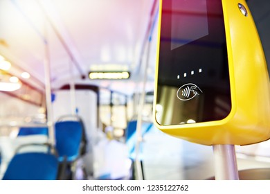 Modern touch payment terminal in bus