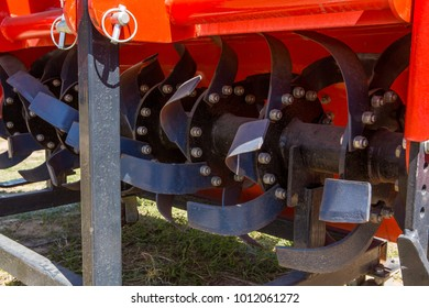 Modern tractor on modern agricultural machinery.