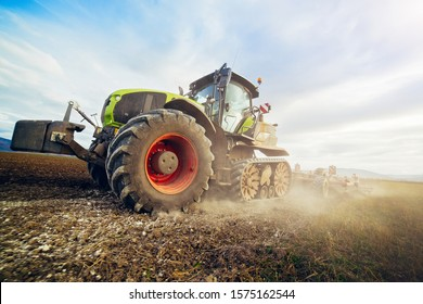Modern tractor working on the field, modern agricultural transport, farmer working in the field, cultivation of land, agricultural machine concept.