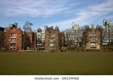 Modern and traditional architecture in Edinburgh, Scotland, green grass, blue sky with few nice white clouds