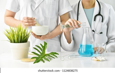 Modern and traditional medical, Alternative organic herbal drug and chemical medicine, Doctor mixing extraction for new pharmacy formulation, Various treatment healthcare.